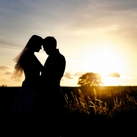 bride-groom-sunset-silhouette